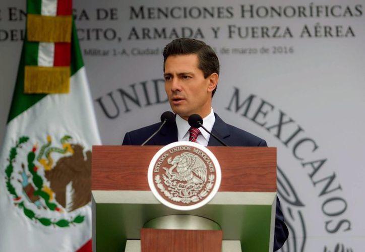 Peña Nieto agradeció, vía Twitter, el segundo informe del Grupo de Expertos Independientes sobre el caso Iguala. (Archivo/Notimex)
