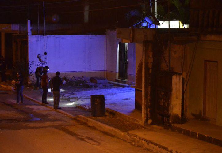 Autoridades ministeriales atendieron el reporte sobre disparos en el bar Laos. (Redacción)