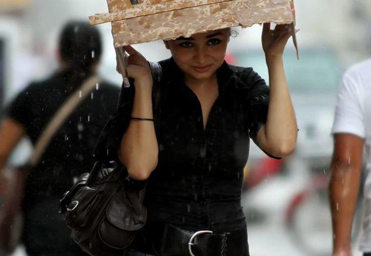 No olvide salir con el paraguas o el impermeable. (SIPSE)