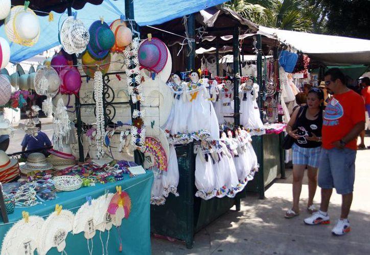 Varios comerciantes esperaban que sus ventas subieran un 70% por vacaciones. (SIPSE/Christian Ayala)