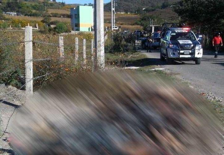 Los once cadáveres fueron localizados en la carretera estatal Chilapa-Ayahualulco. (Facebook/Guadalupe Lizarraga)