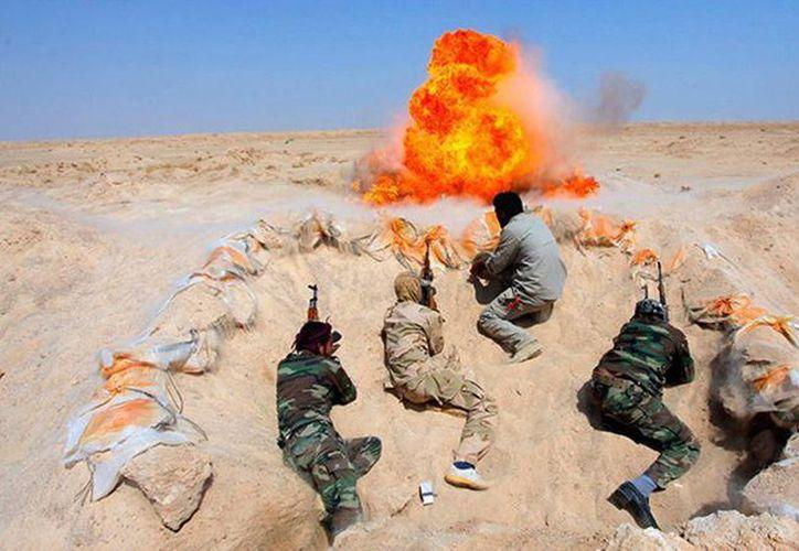 Los líderes del Estado Islámico anunciaron en 2014 que planeaban construir un auténtico califato como el que se describe en los textos sagrados como la única forma aceptable de organización política. Imagen de un grupo de terroristas. (Alaa Al-Marjani/Reuters)