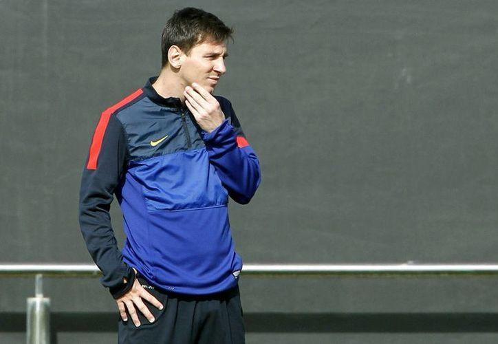El jugador del FC Barcelona, Leo Messi, durante el entrenamiento realizado en la ciudad deportiva del club azulgrana en Barcelona. (EFE/Archivo)