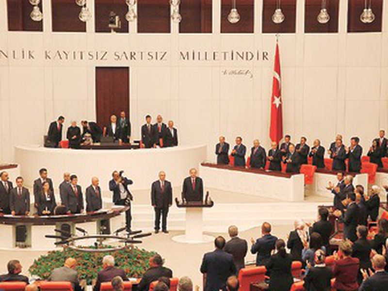 Turkey's President Recep Tayyip Erdogan, center, speaks at the parliament in Ankara, Turkey, when taking the oath of office for his second term as president.