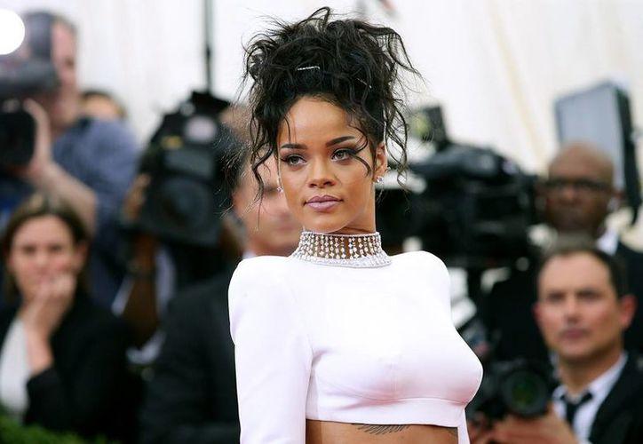 CBS dijo que la propia historia de Rihanna como víctima de violencia doméstica fue parte de la decisión pero no la predominante.(chicagotribune.com)