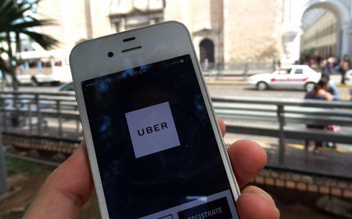 En menos de seis meses, ya suman siete las opciones para usuarios yucatecos de plataformas digitales orientadas a la movilidad: una de ellas es Uber. (Archivo/ Milenio Novedades)
