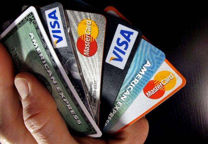 En 2015 se reportó una existencia en el país 22 millones 546 mil 255 tarjetas de crédito. BBVA Bancomer es la institución que más tiene colocadas. (Archivo/Agencias)