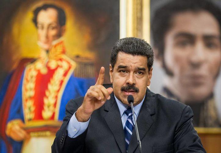 Tras el fallecimiento de Fidel Castro, el presidente Maduro decretó 3 días de duelo nacional en Venezuela. (Archivo/EFE)