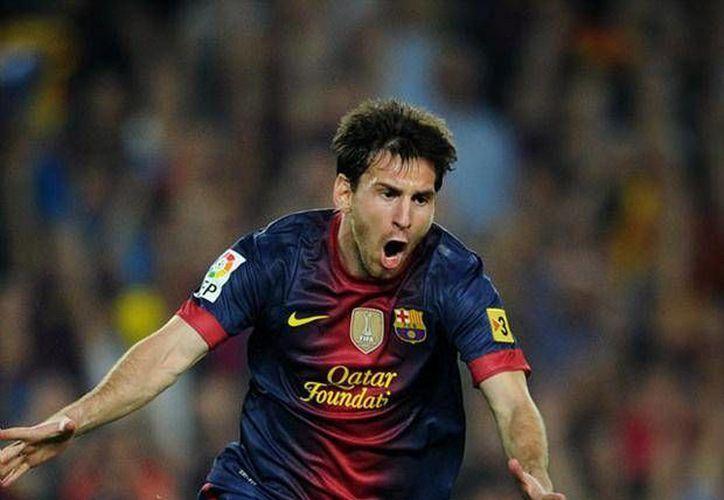 El Barcelona está a punto de volver a ganar el triplete: tras la liga tiene en la mira la Copa del Rey y la Champions. Su estrella Lionel Messi ha contribuido mucho para estos logros. (AP)