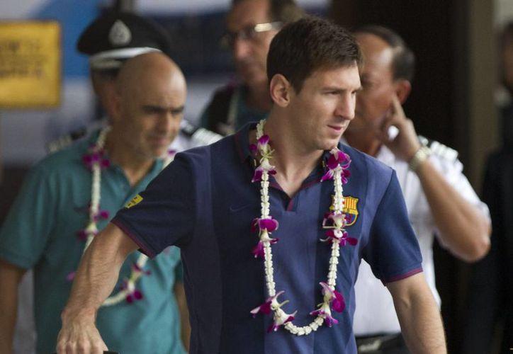 Piqué se dijo asombrado por la capacidad de Messi (foto) de reinventarse torneo a torneo. (Agencias)