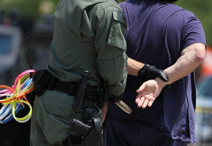 Los activistas detenidos frente a la Casa Blanca aseguraron que se dejaron arrestar y deberán pagar una multa por obstruir las vías públicas. (AP)