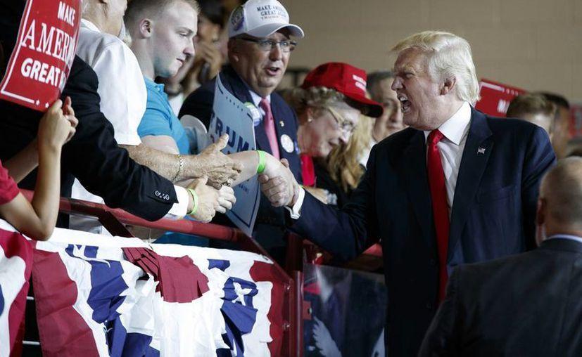 Entre los mismos republicanos, apenas el 38% cree que su candidato Donald Trump es capaz de generar una mayor unidad nacional. En la foto, Trump durante un acto de campaña en Cumberland Valley High School, en Mechanicsburg. (AP)