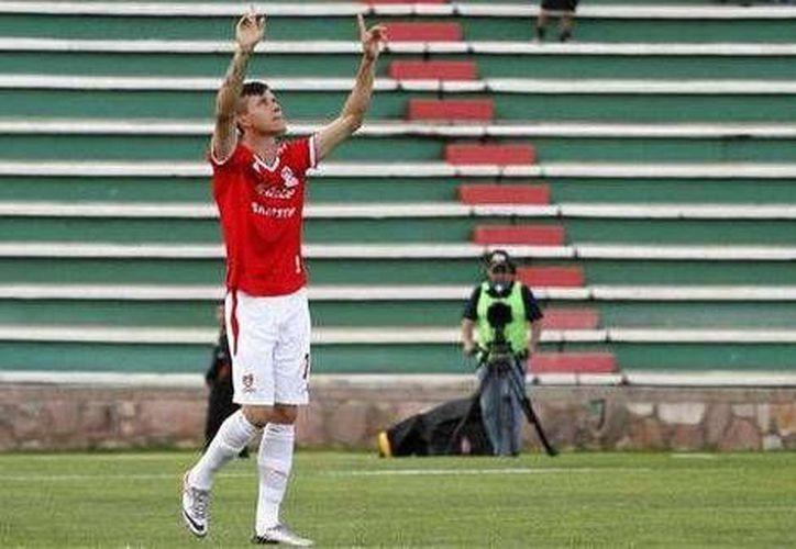 En cuestión de segundos Gustavo Ramírez escribió su nombre con letras de oro en la historia del futbol mexicano. (Foto especial tomada de Milenio)
