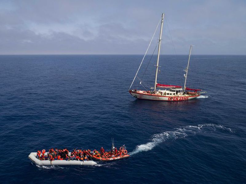Refugees and migrants are transferred to the SOS Mediterranee Aquarius rescue. (AP)