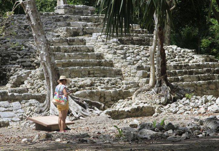 En el Estado hay 13 sitios arqueológicos abiertos al publico, que atraen la visita de los turistas y locales. (Redacción/SIPSE)