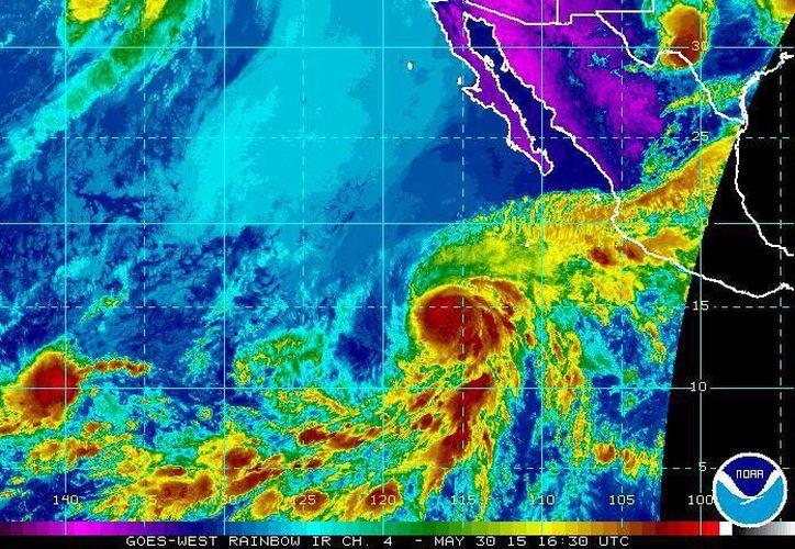 El Huracán Andrés, primero de la temporada en el Pacífico, avanza a mil 125 kilómetros al sur-suroeste de Los Cabos, Baja California Sur. (ssd.noaa.gov)