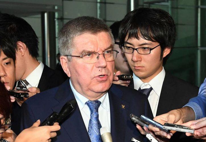 Thomas Bach, titular del COI, dio pie a que se compita en Fukushima, Japón, en los Juegos Olímpicos. (AP)