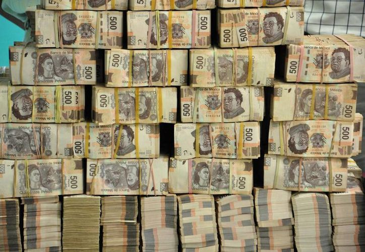 Imagen del 22 de mayo pasado, cuando fue encontrado el dinero en casa del tesorero del exgobernador de Tabasco, Andrés Granier, en Villahermosa. (Archivo/AP)
