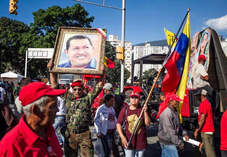La marcha 'antiimperialista' se realizó en coincidencia con el aniversario de la Constitución de Venezuela. (EFE)