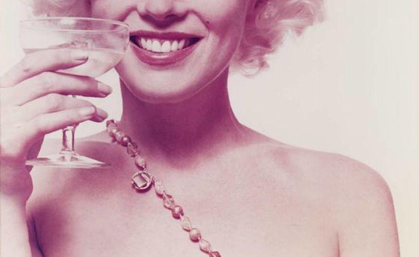 Foto de 1962 suministrada por la casa rematadora Freeman, en Filadelfia, de un portafolio de 10 fotos de la actriz Marilyn Monroe. (Agencias)
