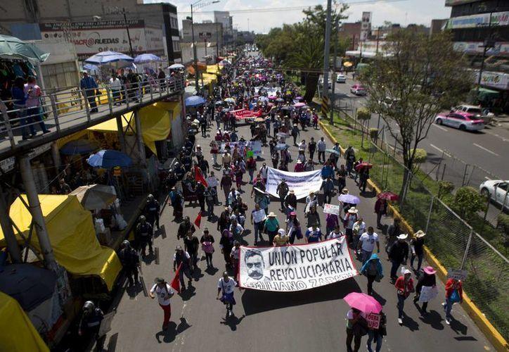 La CNTE se ha manifestado durante meses contra la Reforma Educativa impulsada por el gobierno del presidente Enrique Peña Nieto. (AP)