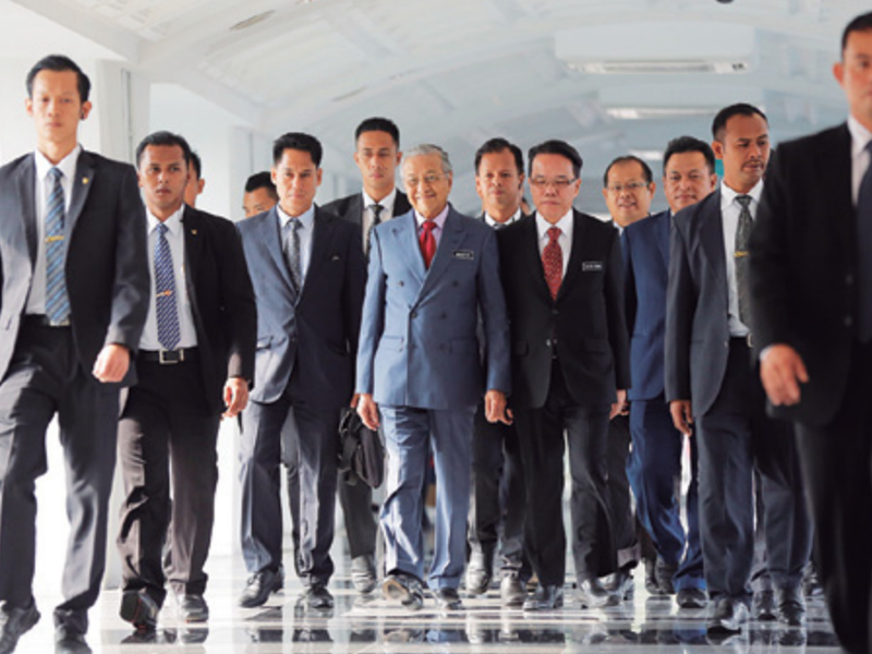 Malasyan Prime Minister Mahathir Mohamad, center, walks to the parliament hall in Kuala Lumpur, Malaysia.