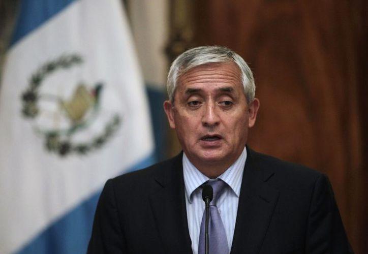 El presidente de Guatemala, Otto Pérez, recordó que el 23 de diciembre fueron asesin adas y quemadas y 7 personas. (todanoticia.com)