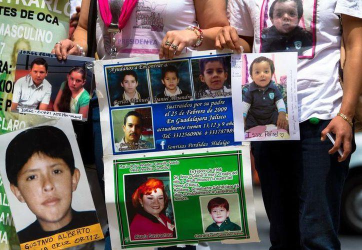 Familiares de víctimas de trata de personas se manifestaron ante la PGR, en la ciudad de México, para exigir una investigación eficaz a sus casos. (Imagen de contexto/Notimex)
