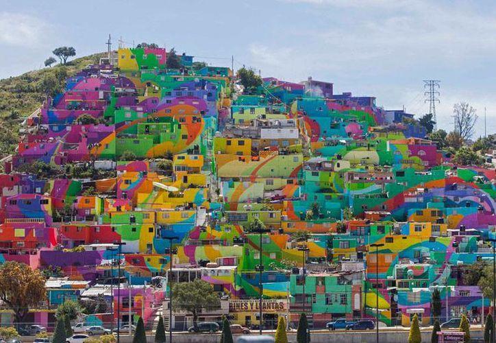 Artistas buscan quitarle al barrio Las Palmitas, en Hidalgo, la imagen negativa de ser un lugar marginal. (The Associated Press)