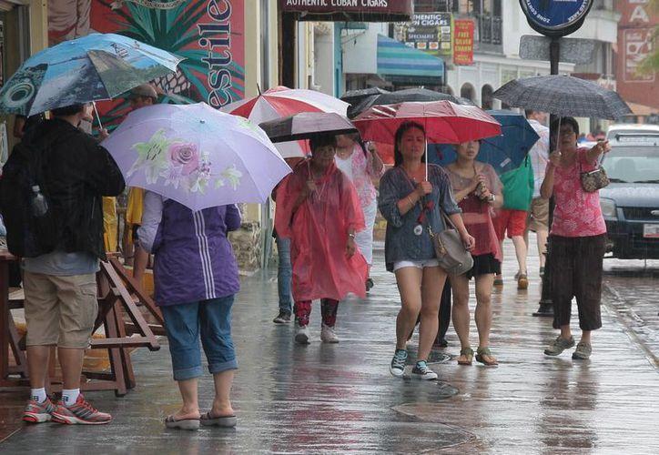 Las constantes lluvias afectó la actividad turística de la isla. (Julián Miranda/SIPSE)