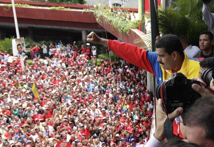 El presidente encargado Nicolás Maduro, designado sucesor por el propio Chávez a finales del 2012, encabezó la ceremonia. (Agencias)