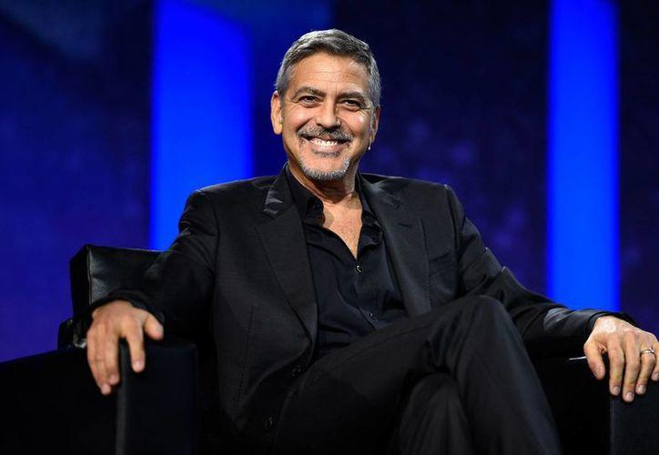 George Clooney informó en un comunicado que la entrevista que publicó la revista Hello! en Reino Unido es inventada. (AP/archivo)