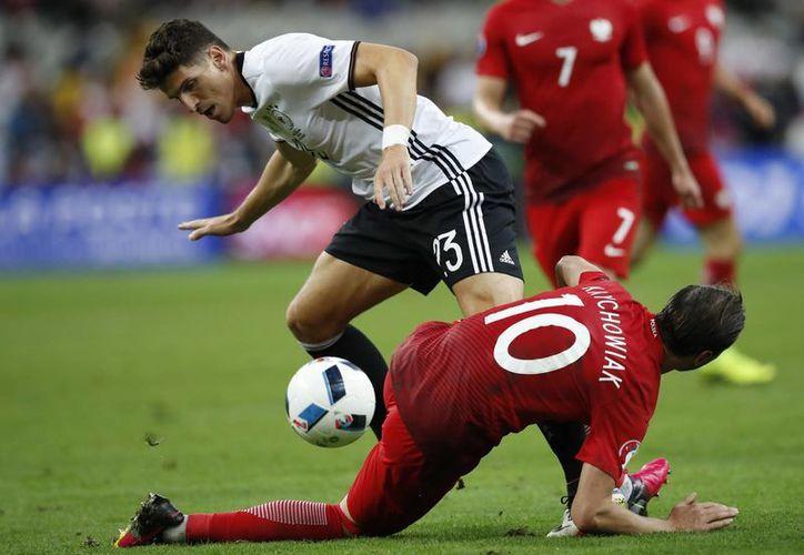 Tras el empate a cero, Alemania y Polonia buscarán asegurar el boleto a los octavos de final de la 'Euro' en el último partido de la fase de grupos. (AP)