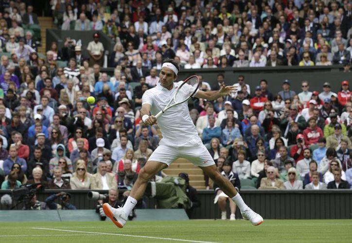 Federer enfrenta ahora en segunda ronda al ucraniano Sergiy Stakhovsky. (Agencias)