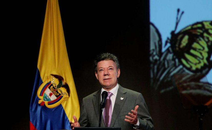 'Hay gente que no comulga con la paz', dijo el presidente Santos aludiendo a traficantes mexicanos de drogas. (EFE)