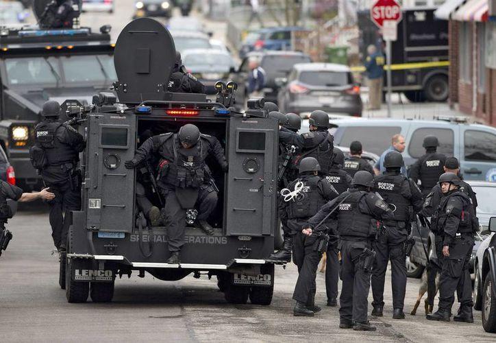 Agentes del cuerpo de elite SWAT de la policía durante una operación. (EFE/Archivo)
