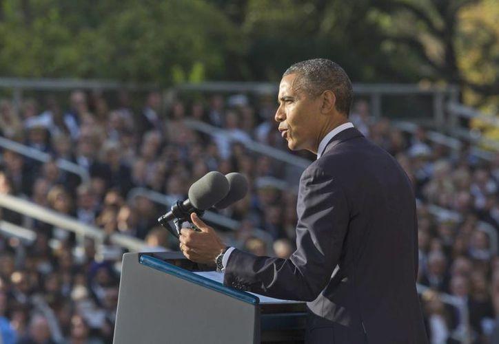 Barack Obama durante un discurso en memoria de las víctimas del tiroteo del pasado lunes en una sede de la Marina en Washington. (EFE)