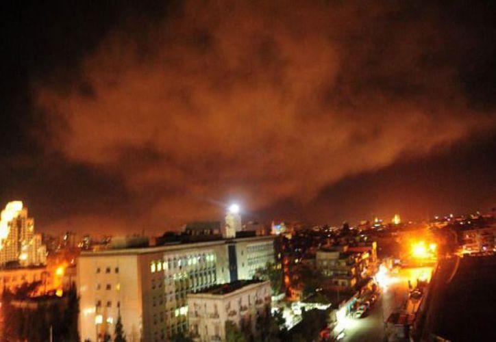 Imágenes de Damasco al momento del ataque. (AP)
