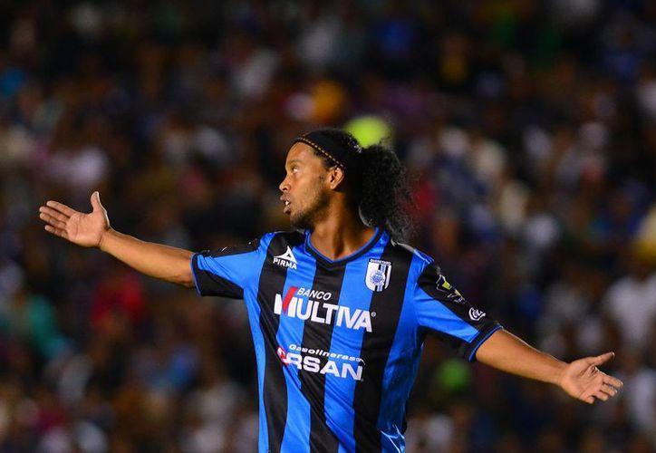 Ronaldinho debutó en el futbol mexicano en el partido ante Tigres de la Copa MX. (Foto: Jam Media)
