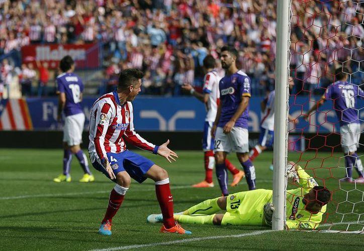 Tiago Cardoso inauguró el marcador por el Atlético a los 43 minutos, Mario Suárez amplió a los 71. (AP)