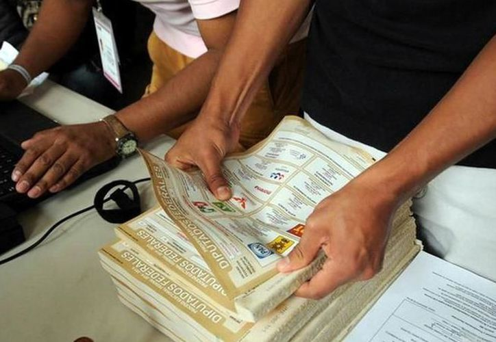 Suspensión temporal de la votación en la casilla 0219 ubicada en la colonia Melchor Ocampo de Kanasín por riesgo de violencia. (Milenio Novedades)