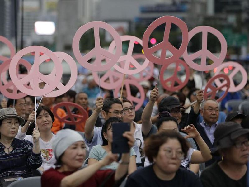 Participants attend at a rally wishing for a successful summit between Donald Trump and Kim Jong Un near the U.S. embassy in Seoul.