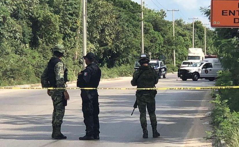 El cuerpo estaba a un costado de la carretera, a la altura de la Región 253. (Redacción/SIPSE)