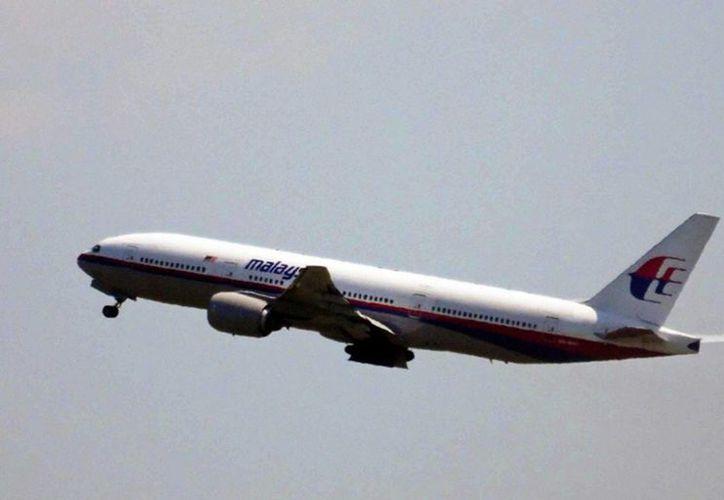 Se espera que el rastreo satelital de los aviones comerciales inicie en 2017. (Archivo/Notimex)