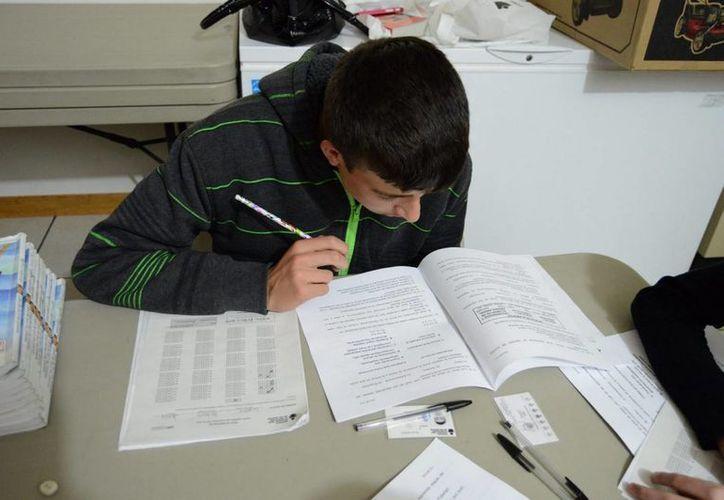 La prueba PISA se aplicó por última vez en México en 2012. (Archivo/Notimex)