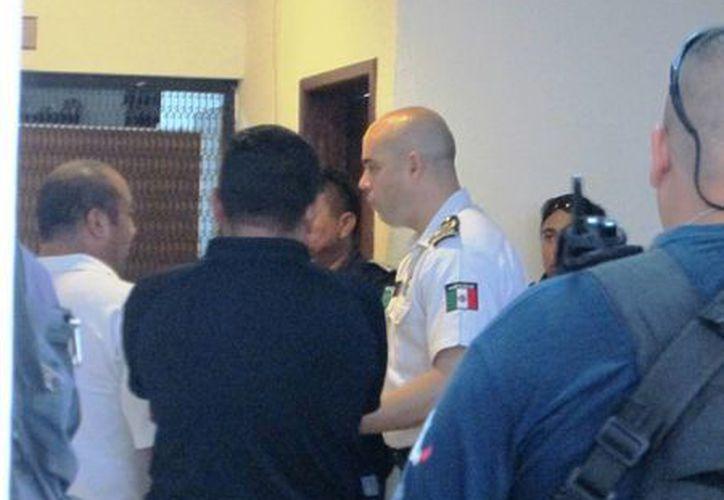 Un policía fue señalado como presunto responsable del robo de $200  y un Iphone a un detenido.  (Irving Canul/SIPSE)