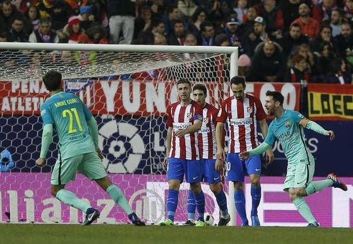 Barcelona ganó 2-1 como visitante al Atlético de Madrid en partido de ida de semifinales de la Copa del Rey. En la foto, Messi al momento de anotar uno de los goles del Barza. (marca.com)
