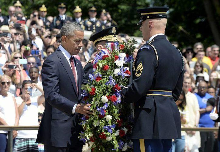 Obama aseguró que la vida de los soldados caídos en combate es una deuda que la nación jamás podrá saldar. (EFE)