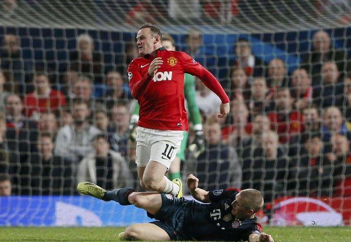 Wayne Rooney se lesionó el martes en el empate 1-1 frente al Bayern en partido de ida, de la Liga de Campeones, en Old Trafford. (Agencias)