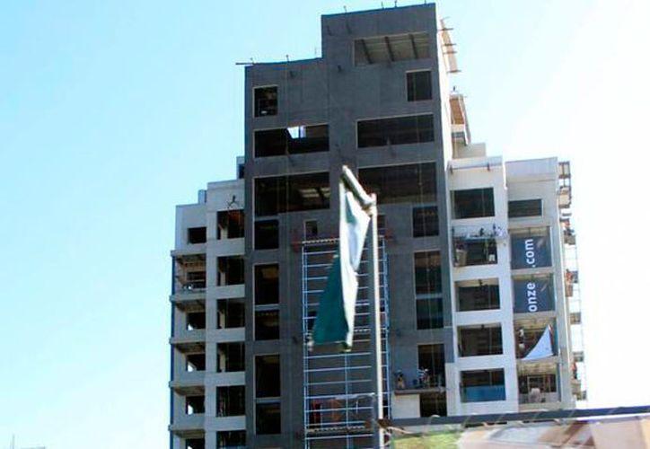 La edificación de condominios está disparando los trámites registrales en Mérida; actualmente, en promedio por día, hay un trámite cada minuto. (Archivo/SIPSE)